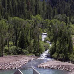 Water heads off into the canyon from Tibble Fork Reservoir on Thursday, June 15, 2017.
