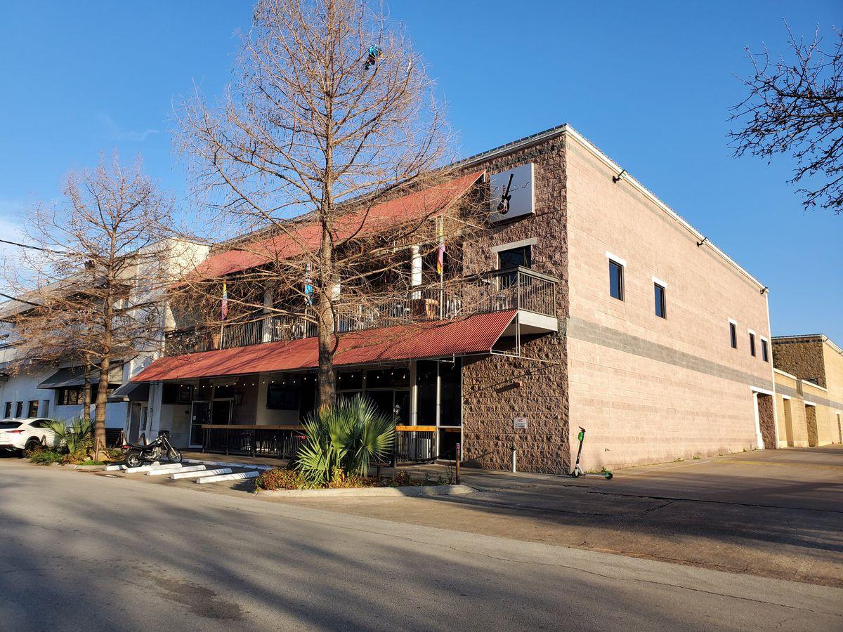 The brown brick exterior of Sue Ellen's, a lesbian bar in Dallas