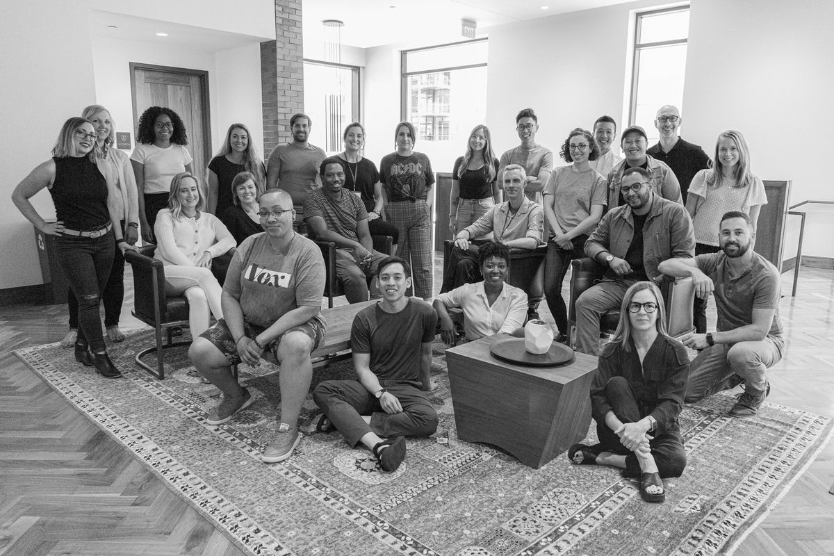 A black and white photo of the Vox Design team members