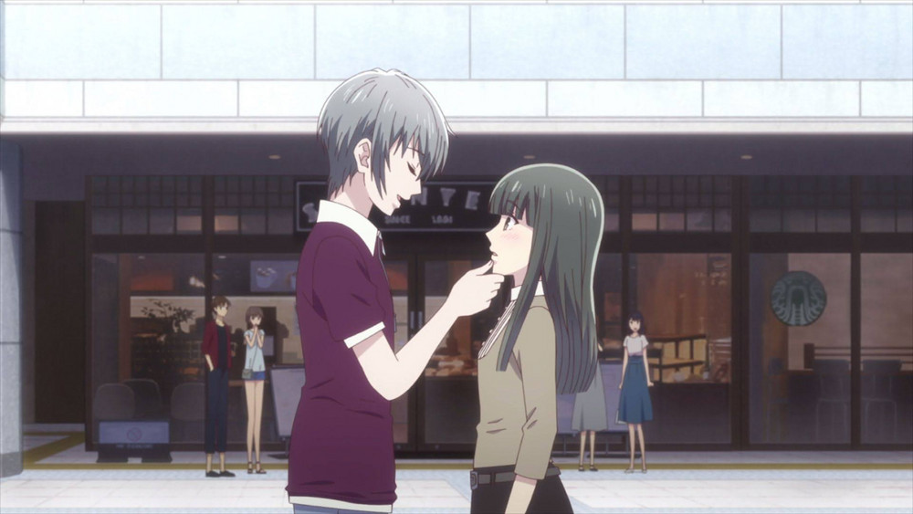 Yuki touching the side of the town's face