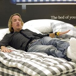 Greg Hardesty finally finds out what's is like to get a good night's sleep as he tests one of the most expensive beds in the world at Hastens in Newport Beach, California, Jul 24, 2009. The bed is one of several models hand made in Sweden with natural materials.