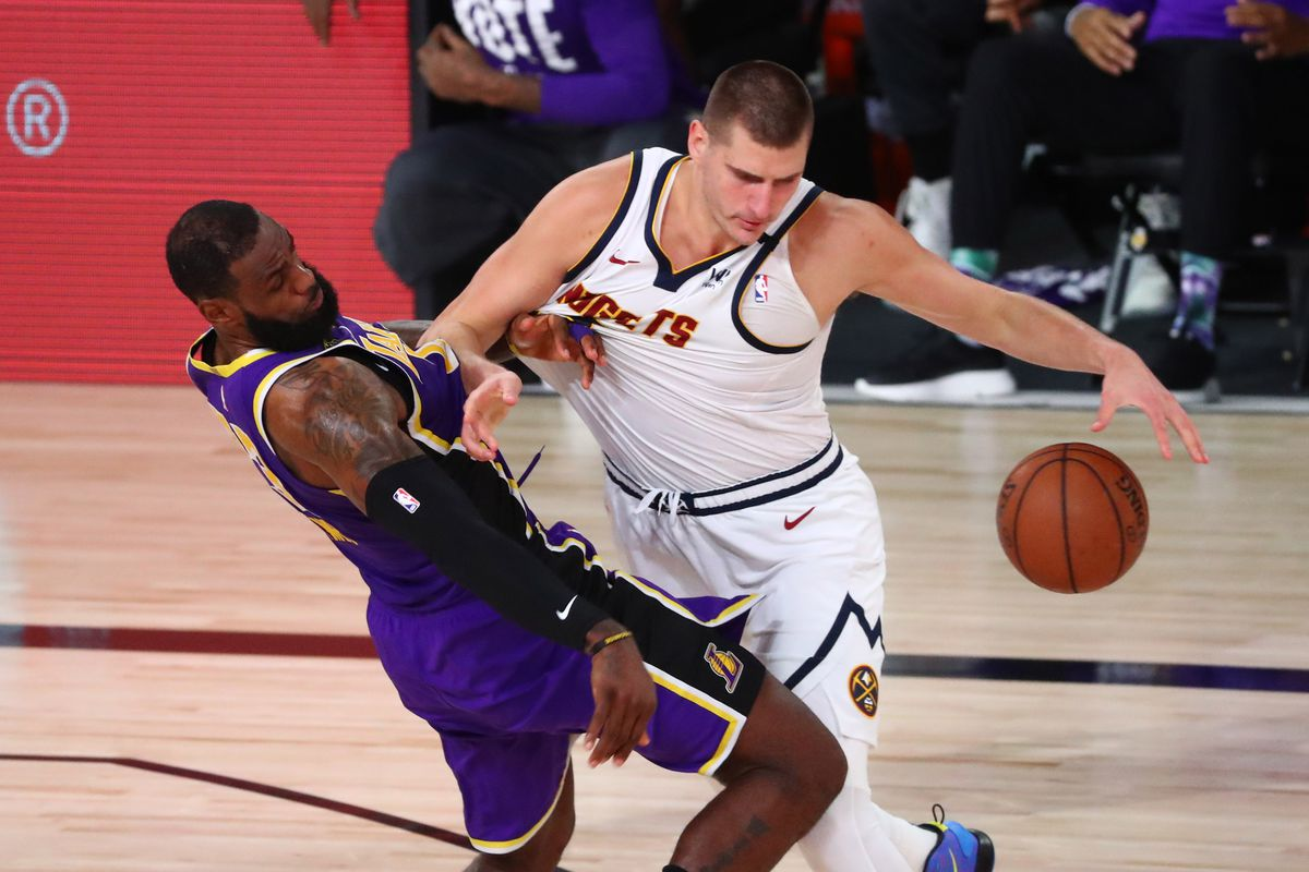 Denver Nuggets center Nikola Jokic is fouled by Los Angeles Lakers forward LeBron James during the third quarter in game five of the Western Conference Finals of the 2020 NBA Playoffs at AdventHealth Arena.
