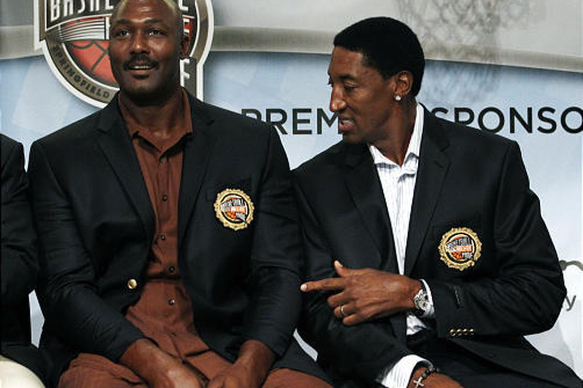 Basketball Hall of Fame inductee Scottie Pippen, right, points to fellow inductee Karl Malone's short jacket sleeves during the enshrinement news conference at the Hall of Fame Museum in Springfield, Mass. Friday, Aug. 13, 2010.