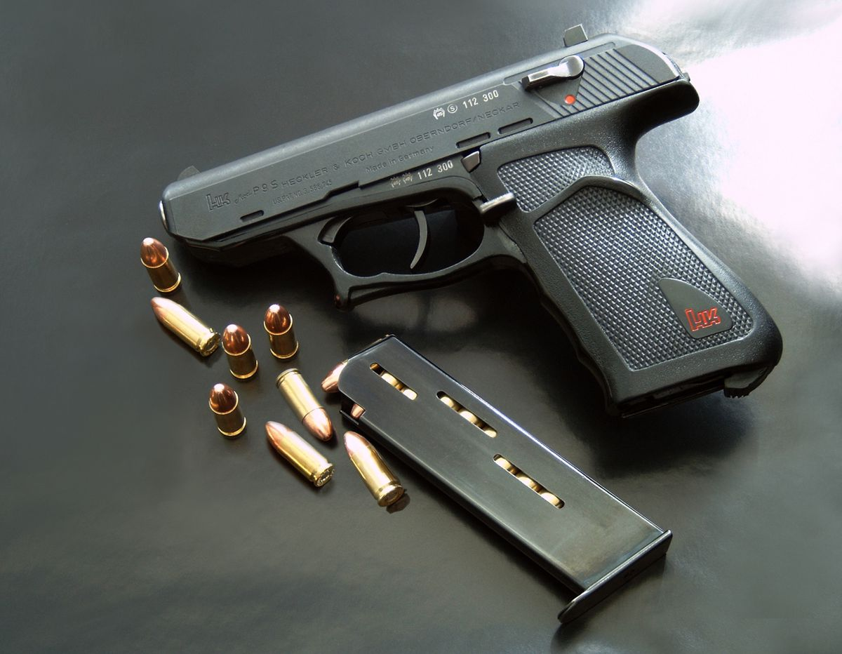 Photo of a Heckler & Koch P9 pistol with magazine detached.