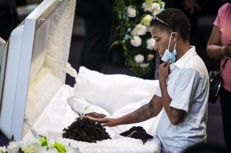 Mourners attend the funeral for 13-year-old Jamari Dent at Greater Harvest Baptist Church at 5141 S. State St. in Washington Park on the South Side, Tuesday, June 22, 2021.