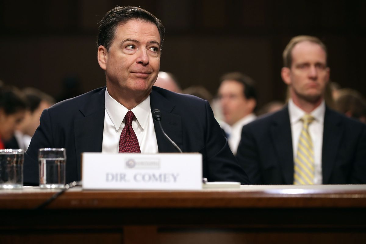 Former Fbi Director James Comey Imitates A Gesture He Said He Saw President Donald Trump Make During One Of Their Conversations While He Testifies Before