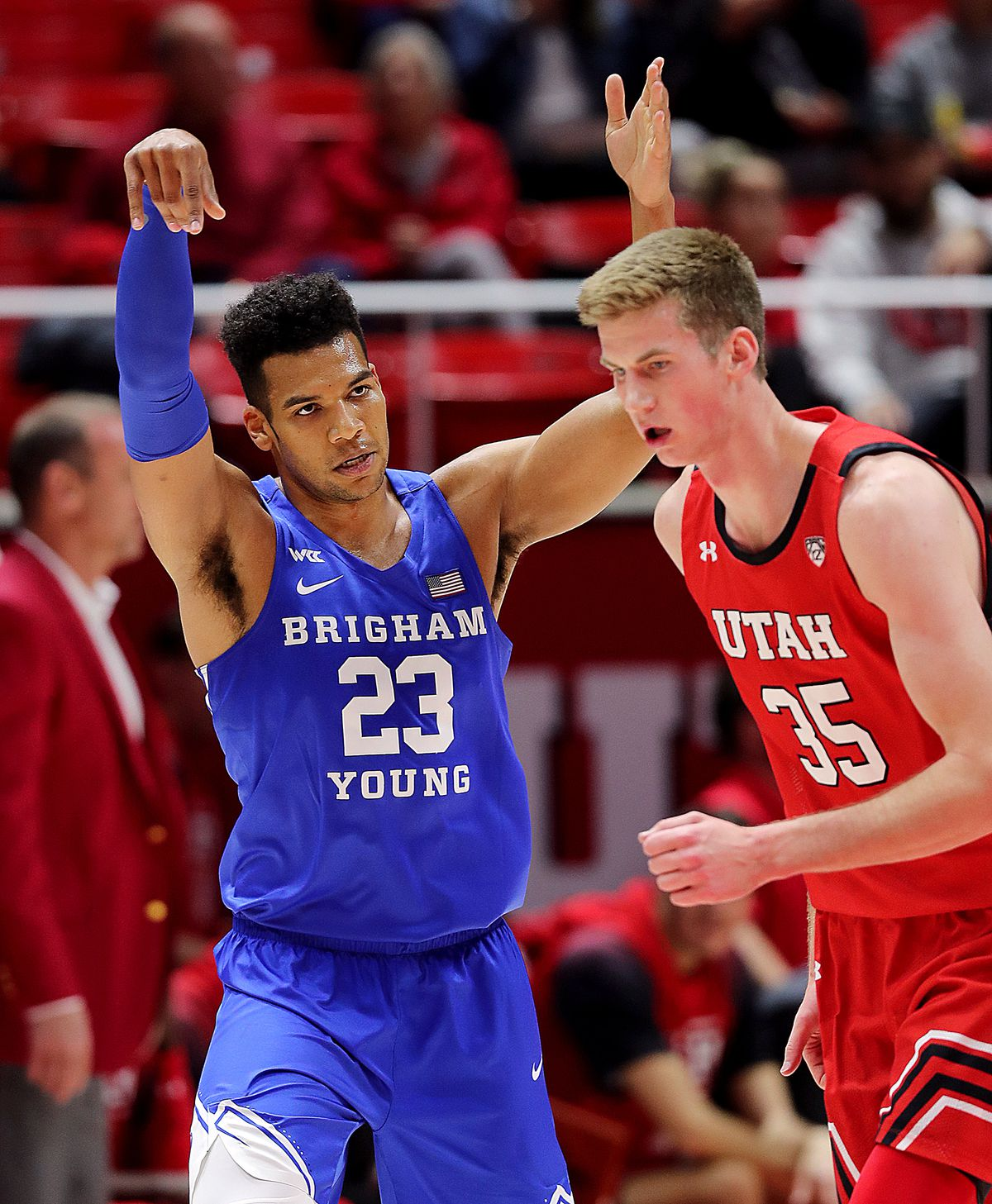 Brigham Young Cougars forward Yoeli Childs (23) reacts after hitting a shot as Utah and BYU play an NCAA basketball game at the Huntsman Center in Salt Lake City on Wednesday, Dec. 4, 2019.