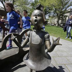 In this May 4, 2017, photo children play near a bronze statue of a Dr. Seuss character at the The Dr. Seuss National Memorial Sculpture Garden, in Springfield, Mass. The Amazing World of Dr. Seuss Museum, which devoted to Dr. Seuss, opened on June 3 in his hometown.