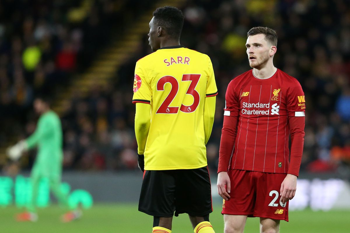 Andy Robertson of Liverpool watches Ismaila Sarr of Watford - Watford FC v Liverpool FC - Premier League