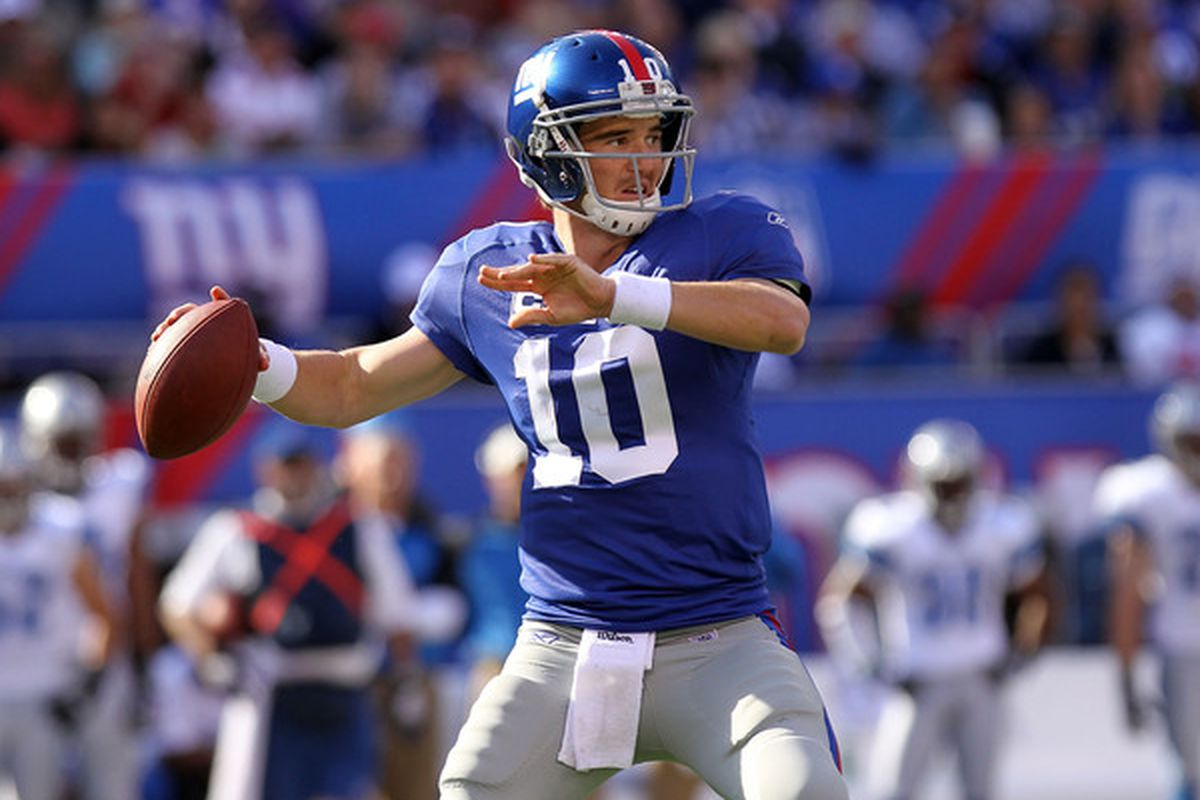 <strong>Eli Manning</strong> (10) of the New York Giants passes against the Detroit Lions at New Meadowlands Stadium on October 17 2010 in East Rutherford New Jersey.  (Photo by Nick Laham/Getty Images)