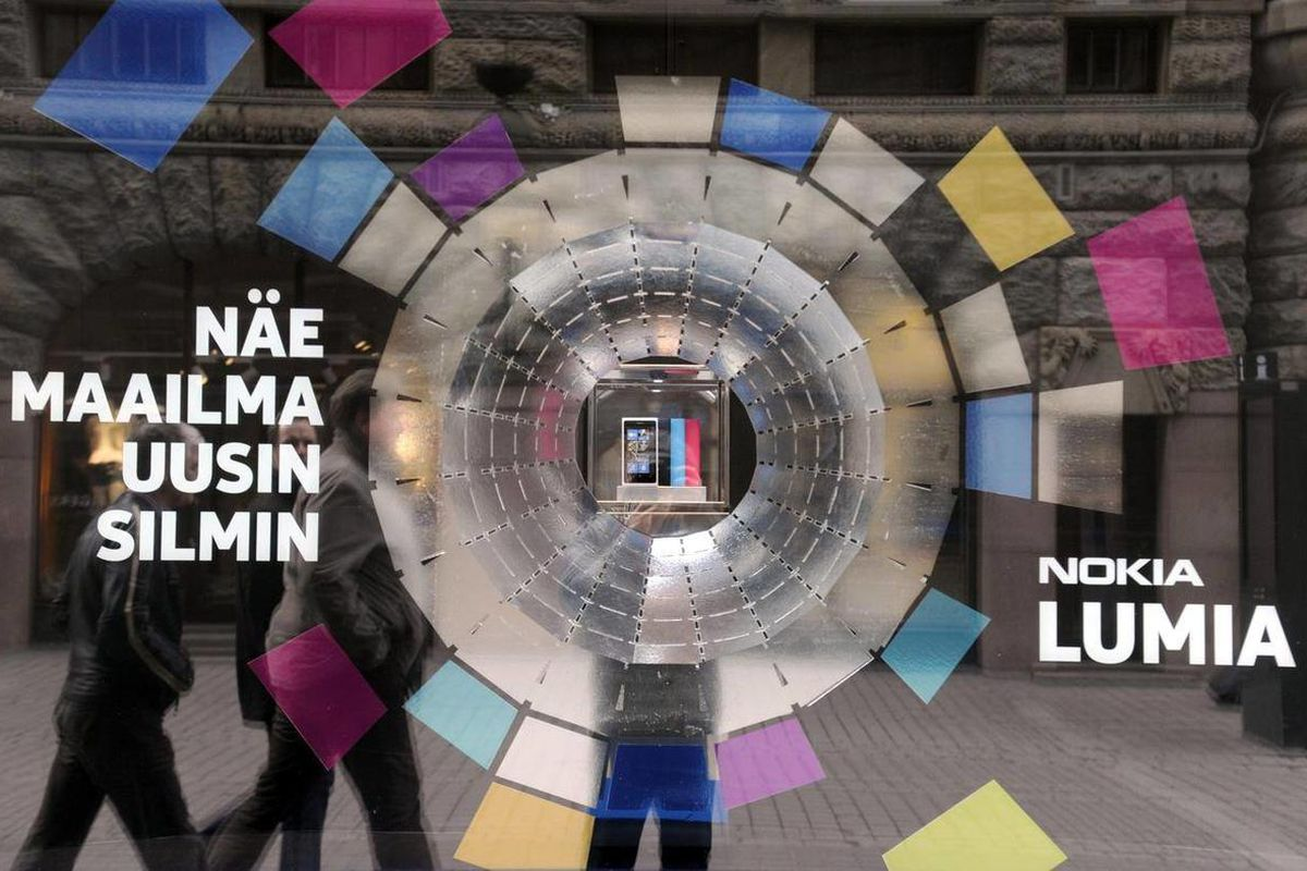 The window of Nokia's flagship store  displays an advertisement of the new Nokia Lumia mobile phone in Helsinki on Thursday, April, 19, 2012 .  Mobile phone manufacturer Nokia published its weak first quarter 2012 results on Thursday.