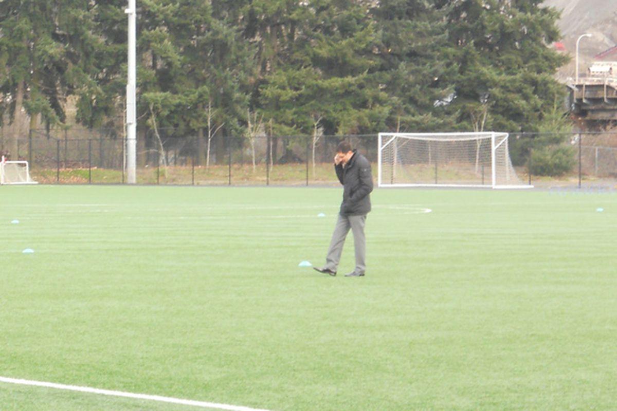 Adrian Hanauer regularly works the phone at practice