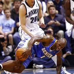 Kyle Korver of the Utah Jazz is called for a foul on Chauncey Billups of the Denver Nuggets as the Jazz-Nuggets play in game 3 of the Western Conference Playoffs in Energy Solutions Arena.