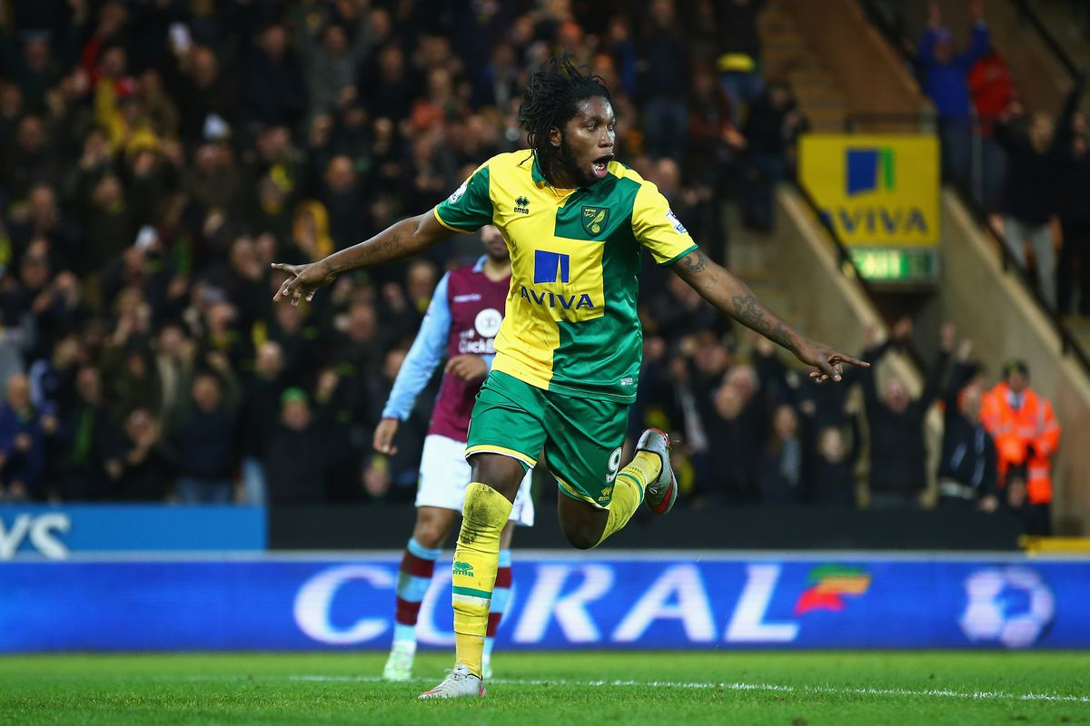 Dieumerci Mbokani of Norwich City celebrates scoring his team's second goal during the Barclays Premier League match between Norwich City and Aston Villa at Carrow Road on December 28, 2015 in Norwich, England.