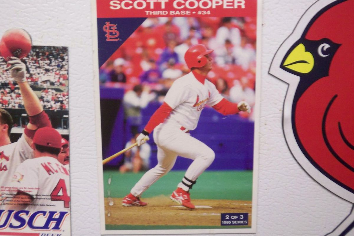 Scott Cooper, two-time all-star, sits between a 1999 Busch Stadium schedule and a car-sized Cardinal magnet on the Moore family refrigerator.