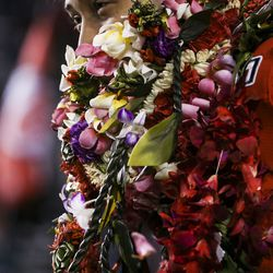 Utah Utes defensive end Bradlee Anae (6) looks out from behind a pile of leis during senior night festivities before the start of an NCAA football game between the Utah Utes and Colorado Buffaloes at Rice-Eccles Stadium in Salt Lake City on Saturday, Nov. 30, 2019.