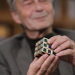Erno Rubik, the inventor of the Rubik's Cube, poses for The Associated Press at Liberty Science Center, Wednesday, April 25, 2012, in Jersey City, N.J. The center is hosting an exhibit on Rubik's Cubes which will include a cube made with diamonds that is worth 2.5 million dollars.