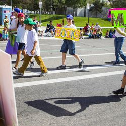 Ian Colton, right, dances along behind the Salt Lake Winder West Stake float during the Days of '47 Union Pacific Railroad Youth Parade held Saturday, July 18, 2015, in Salt Lake City.