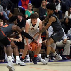 Oak Park's Dan Francis (12) is double teamed by Evanston's Lance Jones (5) and Jaheim Holden (1) during their 79-69 loss in Oak Park,  Saturday, February 2, 2019. | Kevin Tanaka/For the Sun Times