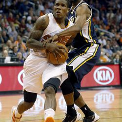 Phoenix Suns' Eric Bledsoe, left, drives past Utah Jazz guard Marvin Williams during the second half of an NBA basketball game on Friday, Nov. 1, 2013, in Phoenix. The Suns won 87-84.