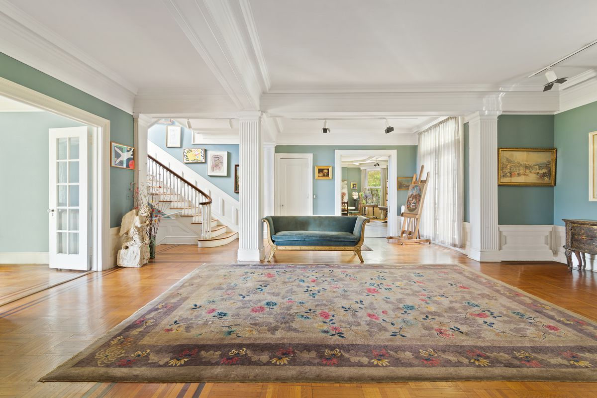 Large room with white columns and French doors.