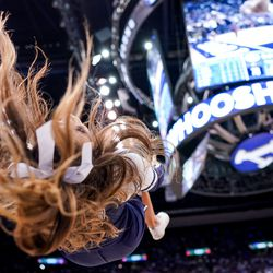 A Brigham Young cheerleader does a backflip during the game against the Gonzaga Bulldogs at the Marriott Center in Provo on Saturday, Feb. 22, 2020.