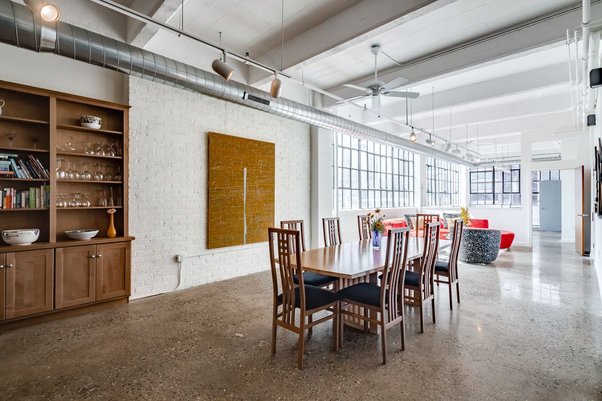 polished concrete floor loft. A Kitchen Sits In The Middle Of Home And Features Red Quartz Island Double Ovens. It\u0027s Connected, Again, By Open Floor Plan To Another Living Polished Concrete Loft
