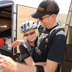 Alta High junior Madeleine Hales hugs her dad and coach Steve Hale as she competes for her school bike racing team during a race at Soldier Hollow Saturday, Aug. 29, 2015.