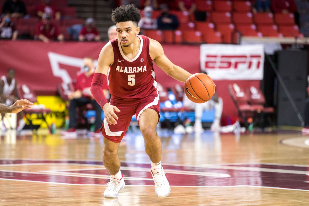 Alabama Crimson Tide guard Jaden Shackelford brings the ball up court during the second half against the Oklahoma Sooners on January 30, 2021 at Lloyd Noble Center in Norman Oklahoma.