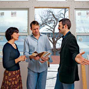 <p>Michele and Michael meet with architect David Webber (center) to choose window treatments for their new master bedroom.</p>