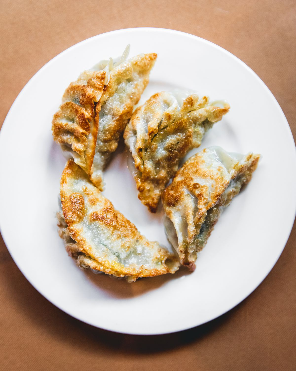 Chinese-style pan fried dumplings on a plate