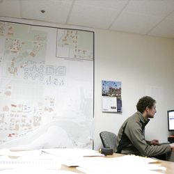 Eric Richardson works on building plans at the facilities planning and design office where he works in the mornings. He works about 12 hours a week.