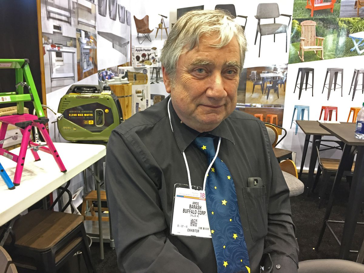 """Amos Barash, vice president of sales at Buffalo Corporation, manning its booth at the 2018 International Home + Housewares Show. He said that doing business is """"more exciting now than it ever was.""""   Neil Steinberg/Sun-Times<br>"""