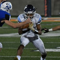 Nazareth's Michael Love (20) protects the ball. Worsom Robinson/For the Sun-Times.