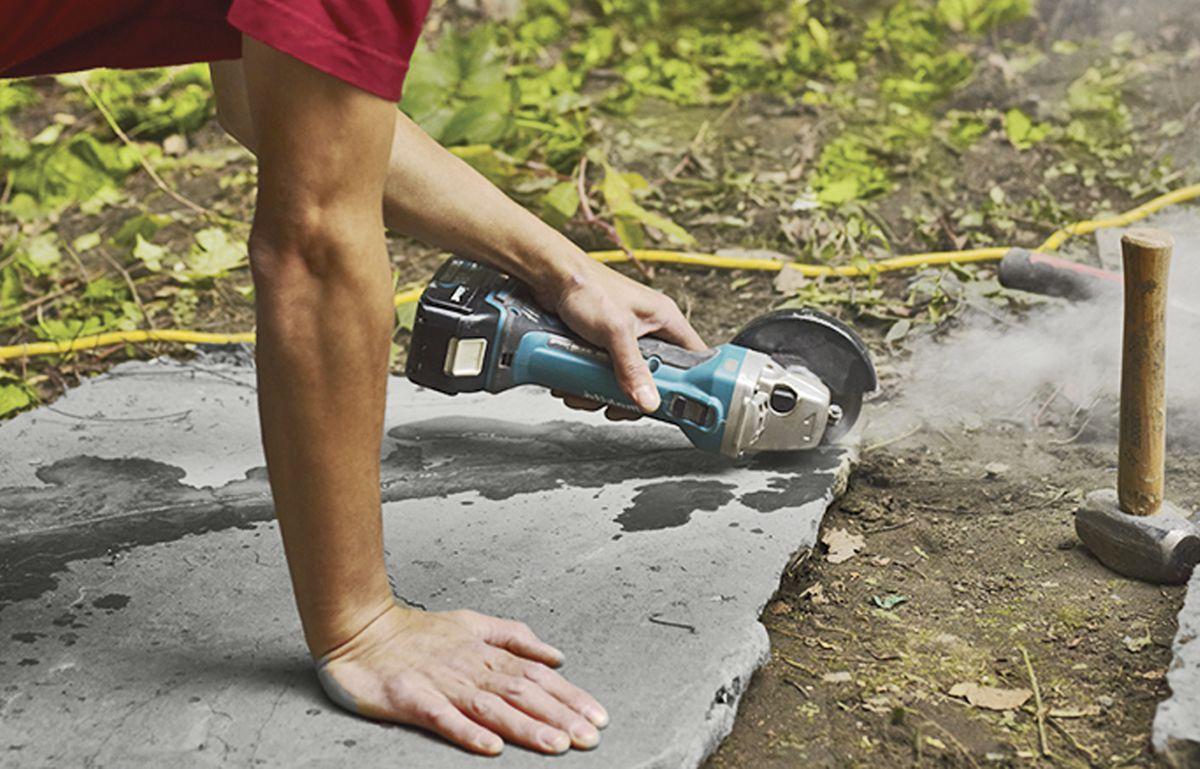 Man Cutting Stone To Make Bluestone Patio