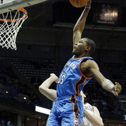 Oklahoma City Thunders' Kevin Durant dunks against Milwaukee Bucks' Ersan Ilyasova, right, during the first half of an NBA basketball game Monday, April 9, 2012, in Milwaukee.