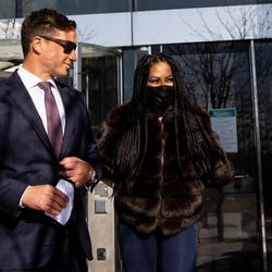 """""""The Real Housewives of Salt Lake City"""" star Jen Shah, right, leaves the U.S. District Court in Salt Lake City on Tuesday, March 30, 2021. Shah, who is married to an assistant football coach at the University of Utah, faces federal fraud charges in New York."""
