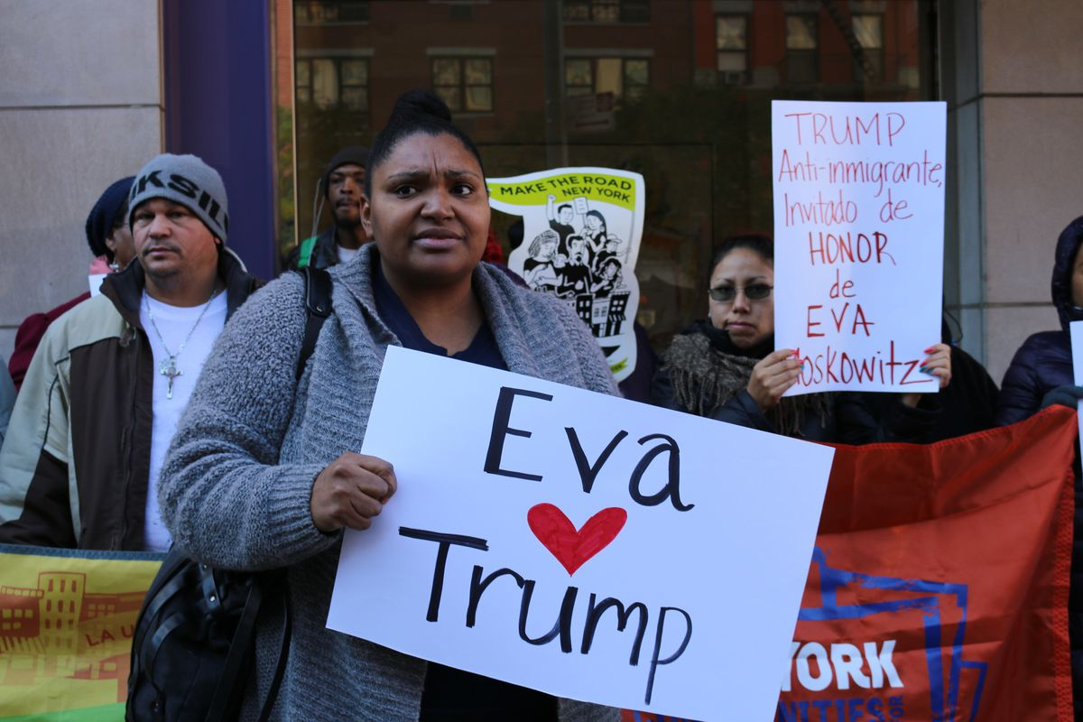 Angel Martinez, a member of the Parent Action Committee, protests in front of Eva Moskowitz's home in November.