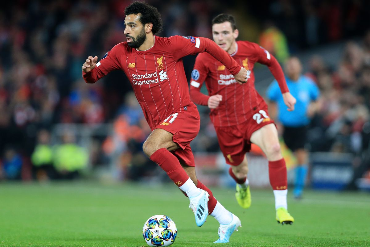 Mohamed Salah in action with the ball, trailed by Andrew Robertson - Liverpool FC - Premier League