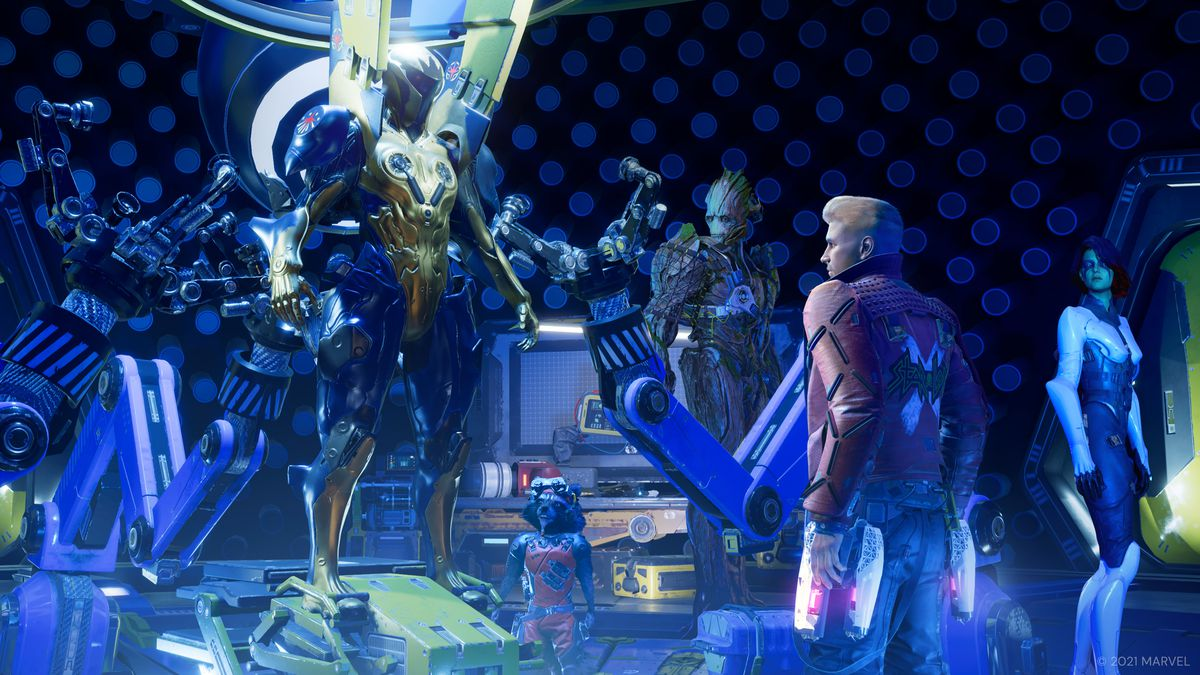 The guardians examine a Nova Corps battle suit standing in a repair bay