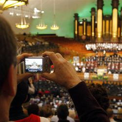 Don Weber takes a photo during LDS Business College's 125th Commencement in the Tabernacle on Temple Square in downtown Salt Lake City Friday, April 13, 2012.