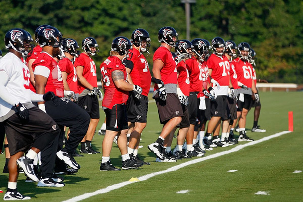 FLOWERY BRANCH GA - JULY 30:  The Atlanta Falcons stretch during opening day of training camp on July 30 2010 at the Falcons Training Complex in Flowery Branch Georgia.  (Photo by Kevin C. Cox/Getty Images)