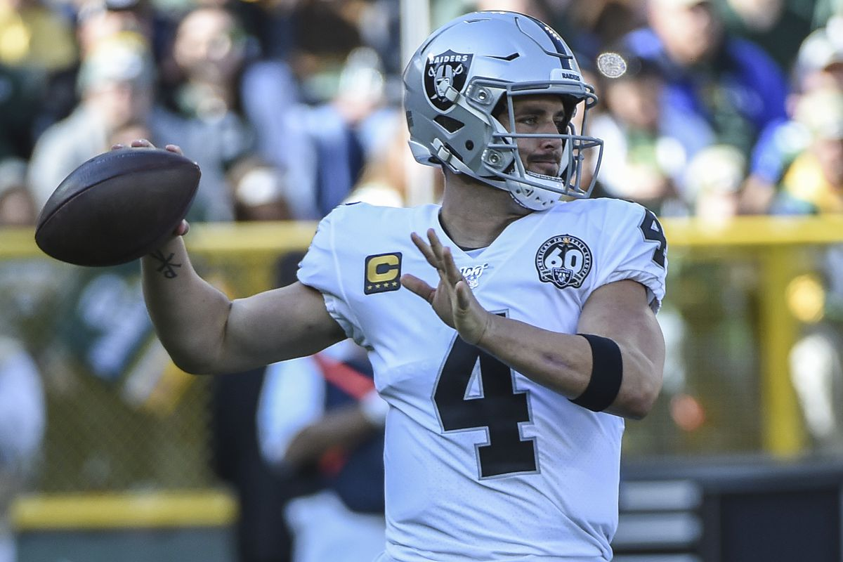 Oakland Raiders quarterback Derek Carr throws a pass in the first quarter during the game against the Green Bay Packers at Lambeau Field.