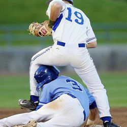 Pleasant Grove's Ben Eldredge slides under and beneath Bingham's Riley Akers at second base as Bingham and Pleasant Grove play Wednesday, May 21, 2014 in a 5A one-loss bracket game at Kearns.
