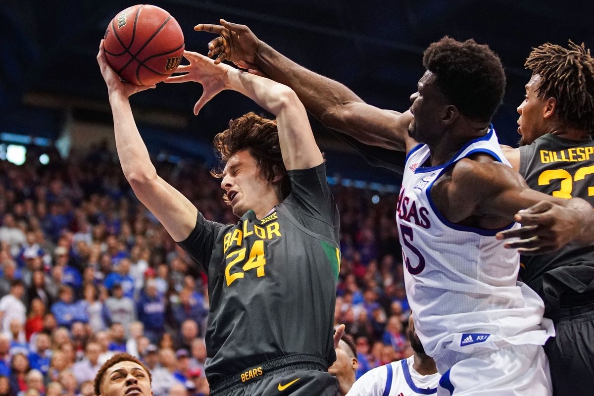 Baylor Bears guard Matthew Mayer and forward Freddie Gillespie fight for a ball against Kansas Jayhawks center Udoka Azubuike during the second half at Allen Fieldhouse.