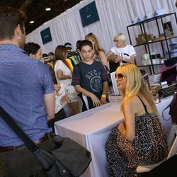 """Celeb stylist Rachel Zoe signed copies of her latest tome, <i>Living in Style</i>, at Kitson's booth. We overheard her calling this young fan """"a prodigy""""—wonder what he said."""