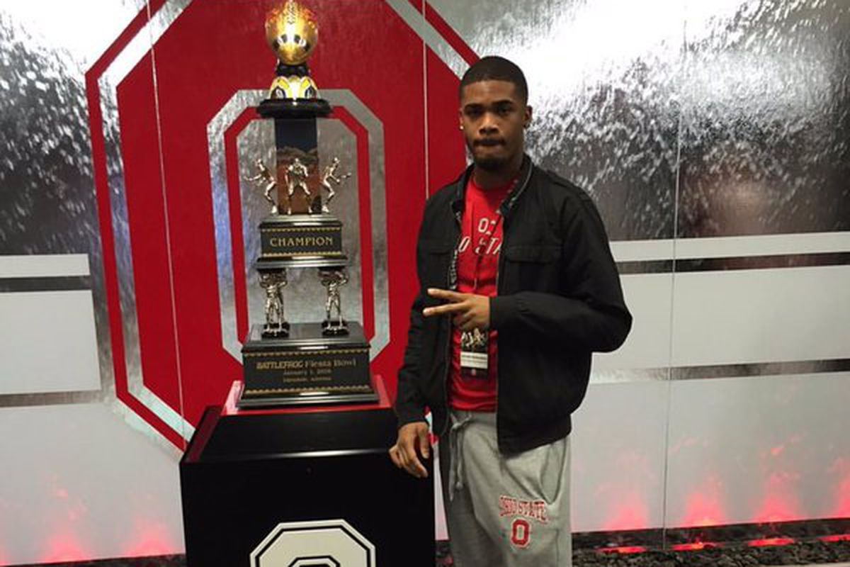 JaVonte Richardson on the Ohio State campus next to their 2015 CFP trophy, courtesy of Ryan Donnelly