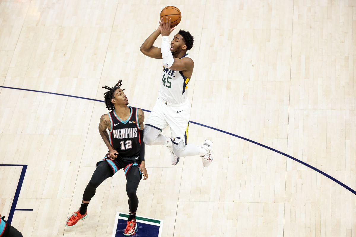 Utah Jazz guard Donovan Mitchell shoots over Memphis Grizzlies guard Ja Morant in Salt Lake City on March 26, 2021.