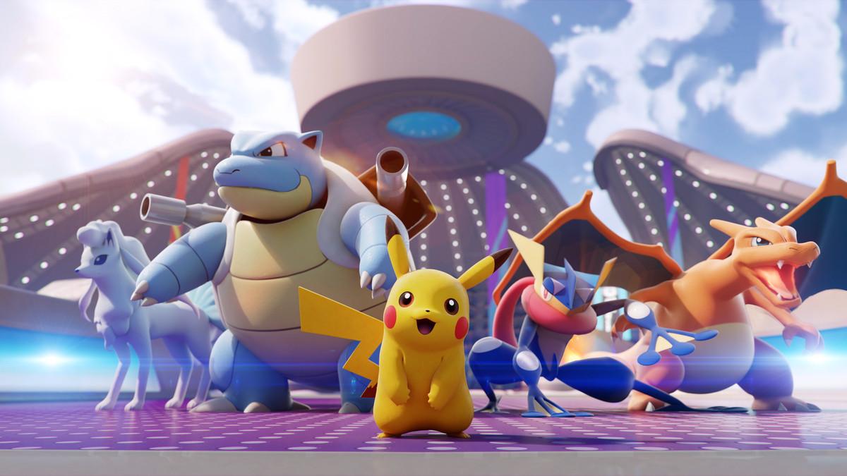 a shot of four pokemon in front of stadium for pokemon unite
