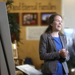 Emily Utt, a historian for The Church of Jesus Christ of Latter-day Saints, talks about upcoming Salt Lake Temple renovations during a press conference at the Temple Square South Visitors' Center in Salt Lake City, Wednesday, Dec. 4, 2019.
